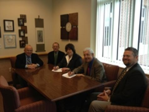 Left to right: Touro Law alum Bruce K. Gould '84; Touro Law Assistant Dean for Admissions George Justice; Touro Law Dean Patricia Salkin; Dean of UCF's College of Health & Public Affairs Michael Frumkin; and UCF Legal Studies Chair James Beckman sign the 3+3 program agreement between Touro Law Center and UCF.