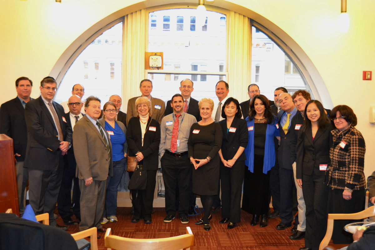 Dr. Alan Kadish, president and CEO of Touro College (back row, center), stands with several members of the Touro faculty at a reception honoring published authors included in the 2012 Touro Faculty Publications.