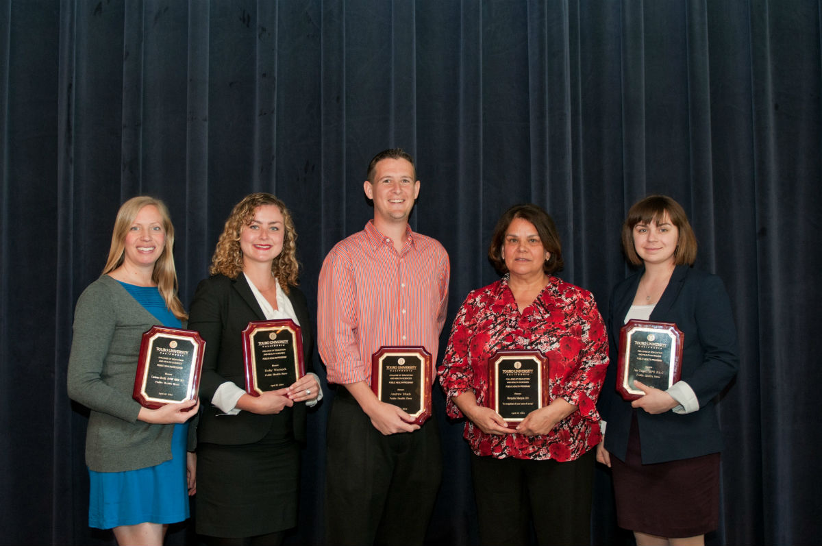 TUC honored six students, faculty, and community members who have made significant contributions and demonstrated a commitment to public health service and research. They are, from left to right: Carinne Brody, MPH, MA, DrPH; Ruby Warnock, MPH; Andrew Muck, MPH; Marquita Marquis, RN; and Joy Dugan, MPH, PA-C. Missing is Kathy Hahn, RN, MSN, CPNP.