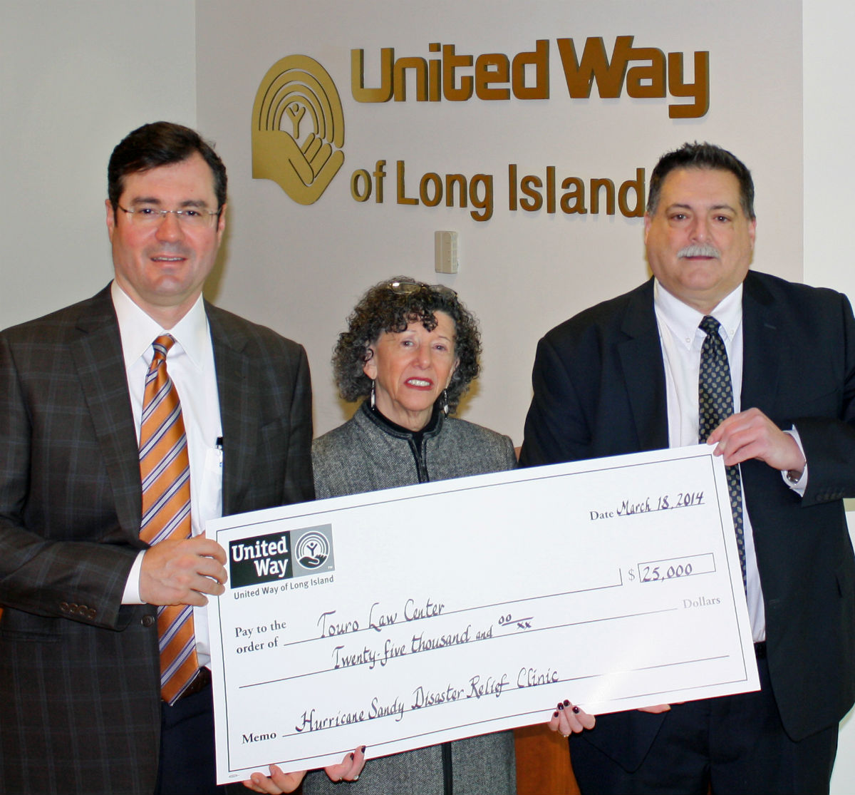 From left to right: John Corrado, President, Suffolk Transportation Service, Inc. & Past Chair, United Way of Long Island Board of Directors; Linda Howard Weissman, Touro Law Center Asst. Dean for Institutional Advancement; and Thomas Maligno, Touro Law Center Director of Public Interest.